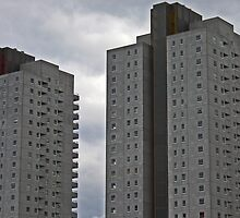 Grey apartment building by Intrepix