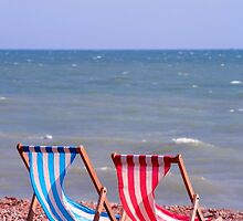 Two deckchairs on the beach by Tony Steel