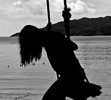 Girl on a swing by Bernie Rosser