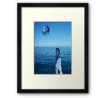 Woman in blue Framed Print
