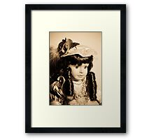 Doll with dark curls Framed Print