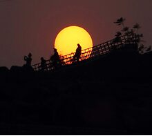 """The ball of fire - sunset over a rockgarden."" by debjyotinayak"