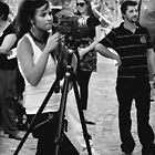 Girl Making A Video by Andrew  Makowiecki