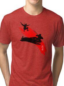 Ninjas having a sword fight.  Tri-blend T-Shirt