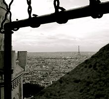 Through Chainlinks - View of the Eiffel Tower from the Sacré Cœur basilica in Montmartre by Britland Tracy