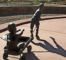 Assisting Superman...  a statue of brothers at play by Jan  Tribe