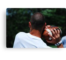 A Firm Grip on the Ball Canvas Print