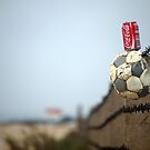 World cup satire - Barbed wire, a ball and coca cola by dcordeiro