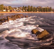 Sunrise with a rock and some waves by MitzPicz