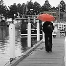 Katie with the red umbrella by Christine Oakley