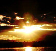 sunburst over blue rock lake by waterchild