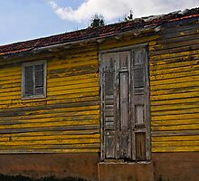 Old Yellow wooden house, Cienfuegos, Cuba by buttonpresser