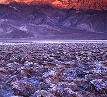Dried up sea, arid desert with majestic mountain with golden Alpen glow by Soumya Mitra