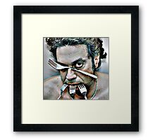 dramatic face of man with four steel forks Framed Print