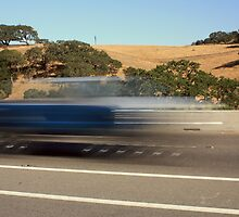 Blurred pick-up truck traveling down the road by gregorydean