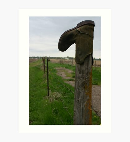 Old worn out cowboy boot on a wooden fence post Art Print