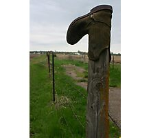 Old worn out cowboy boot on a wooden fence post Photographic Print