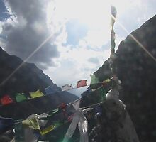 Prayer flags in the Sun at Kunzum pass in Spiti, India by Chris Blyth