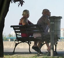 couple sitting by the river in the hot day by Rada