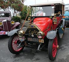 Classic cars: old FIAT and an old Lancia in the background by presbi