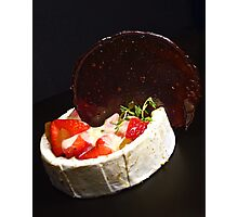 Strawberry and rhubarb jelly salad served with a sweet fondue sauce and a licorice candy disk Photographic Print
