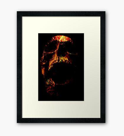 Trickster Skull Framed Print