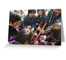 Lighting incense sticks, Lama Temple, Beijing, China Greeting Card