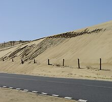 Isolated road along french dune by shkyo30
