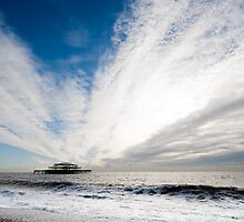 Clouds over Brighton West pier by Kevin  Poulton