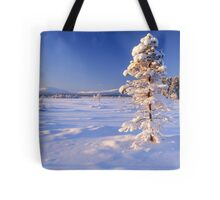 Snow covered trees in north Sweden Tote Bag