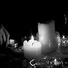 A woman with candles by Ninit K