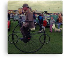 Man on a Penny Farthing Canvas Print