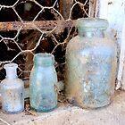 Old bottles on old windowsill. by Julie Sleeman
