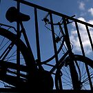 Paris, Bicycle in the blue sky. by Jean-Luc Rollier