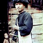 Portrait of a Black Lahu man, Thailand by John Spies