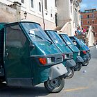 Row of Piaggio 'Ape 50s' by Sue Knowles
