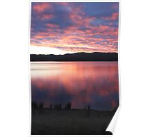 pink sky over blue rock Poster