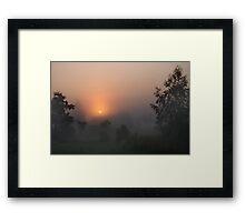 Sunrise in mist Framed Print