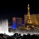 Eiffel Tower and Bellagio Fountains at night by PrecisionFX