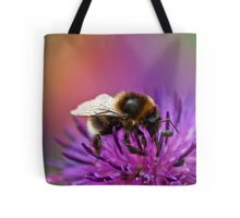 Busy Bee working hard on a wild flower in the Meadow  Tote Bag