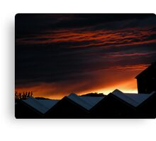 the sky was on fire over mountains of metal and concrete Canvas Print
