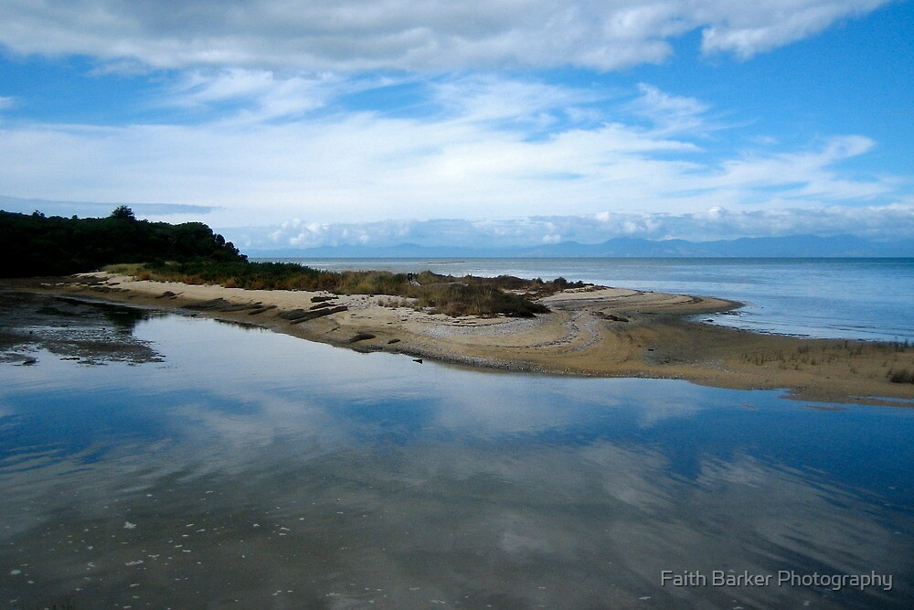 Clouds reflecting in the water at the gateway to the Abel Tasman National Park by Faith Barker Photography