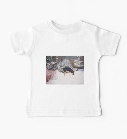 Winter snow scene with cute black and tan dog  Baby Tee