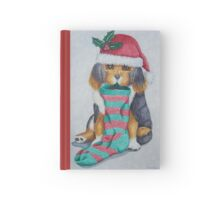 cute black and brown puppy with christmas stocking Hardcover Journal