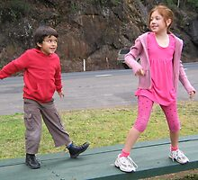 Two Kids Doing A Dance at a Waterfall Viewing Stop. by Maureen Dodd