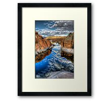 Between A Rock and a Cloud Space Framed Print