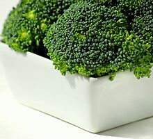 Fresh, green broccoli by Suzanne Edge