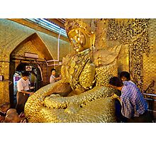 sitting Buddha with thick layer of golden leaves Photographic Print