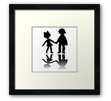Boy and girl silhouettes Framed Print