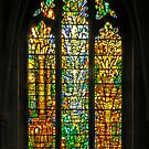 Stained glass window by Tom Denny, Tewkesbury Abbey, England by Philip Mitchell